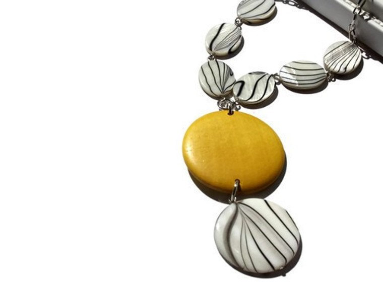 Chunky necklace in yellow, black and white lake shells and wood beads. Pendant necklace. Wood necklace.