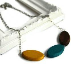 Chunky bead necklace. Trendy necklace with wood beads in brown, teal and yellow.